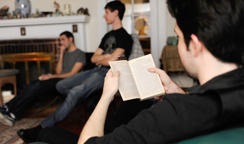 Honors class reading together in the deans house